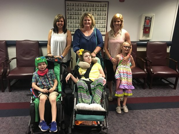 Families who helped push through the passage of Leni's Law were at the Alabama State House on Wednesday. From left are Meggan Jackson of Lester and her son, Caden; Kari Forsyth of Athens and her daughter, Chesney; and Brittany Townsend of Hueytown and her daughter, Kenna. (Mike Cason/mcason@al.com) ( )